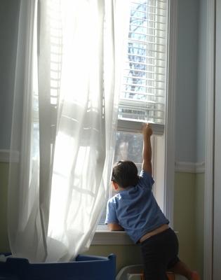 Boy and Window Blind Venetian