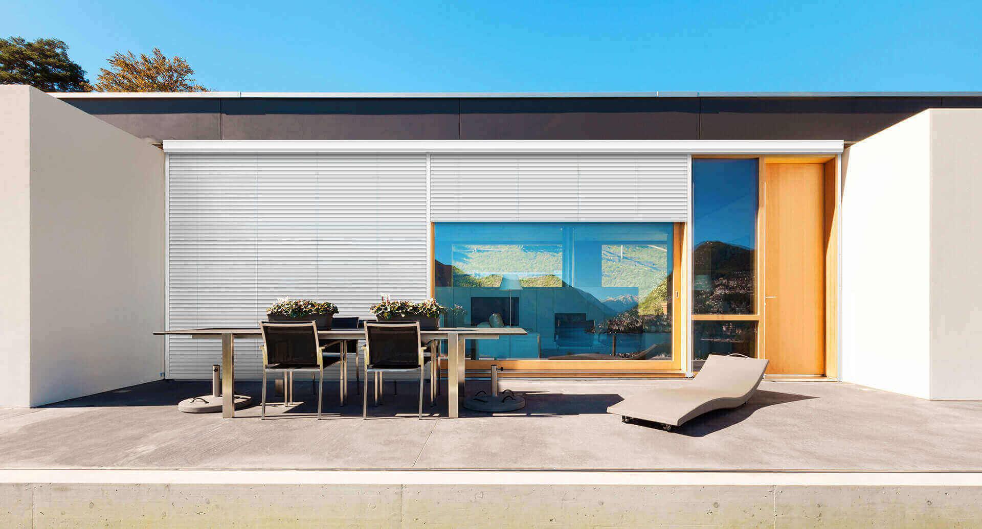 External white roller shutters on living room windows
