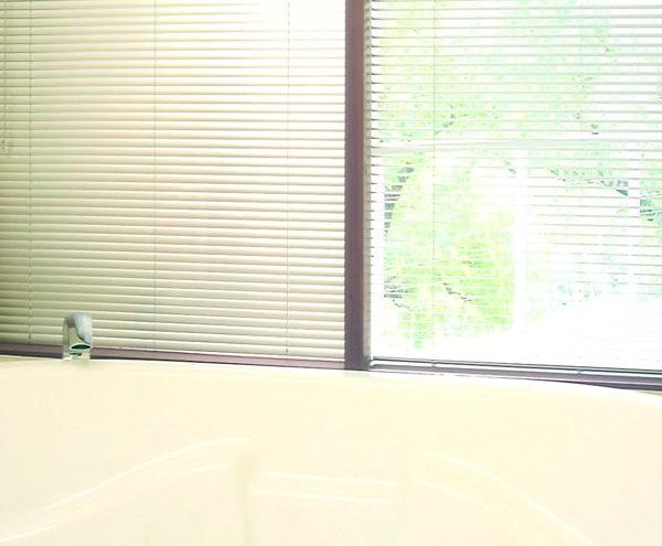 Venetian Blinds - venetian blinds installed on bathroom windows
