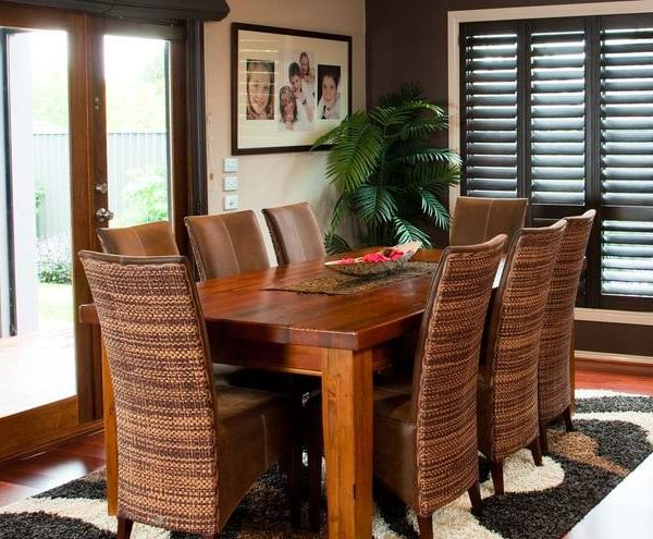 Plantation Shutters - Dining room with dark timber plantation shutters