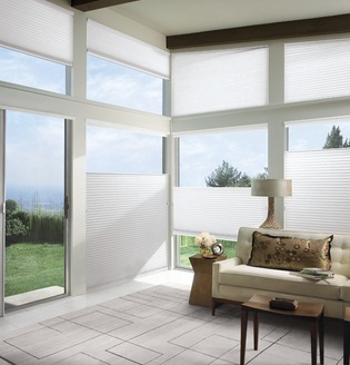 Honeycomb Shades - white honeycomb shades installed on living room windows